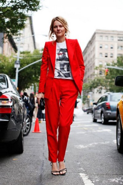 white graphic t-shirt with red suit jacket and matching trousers