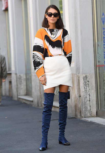 white green and black printed sweatshirt with white wrap skirt