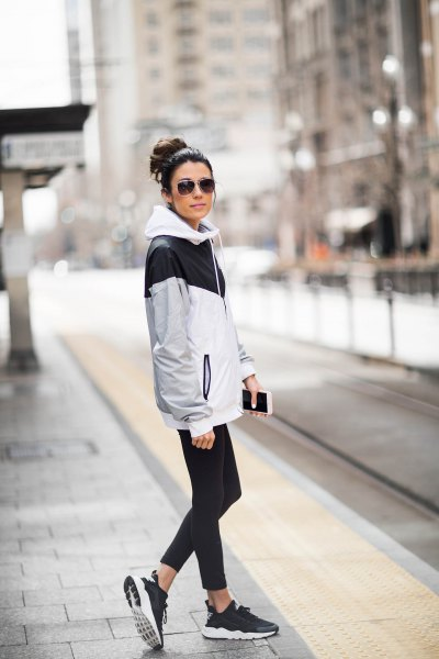 white-gray and black windbreaker with short skinny jeans