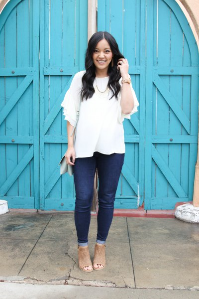 white blouse with half sleeves, dark jeans and open toe boots