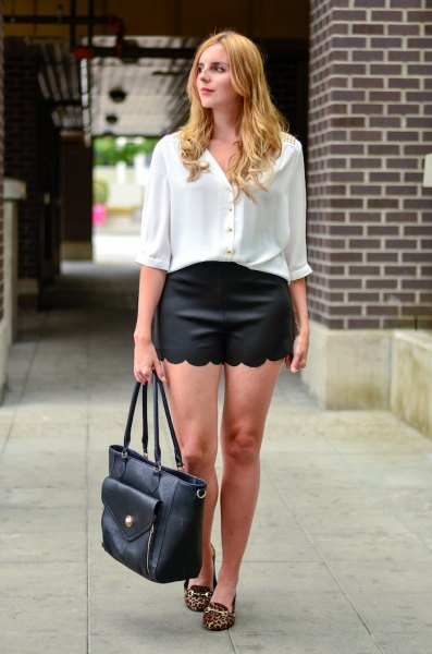 white shirt with buttons and half sleeves, black scalloped shorts