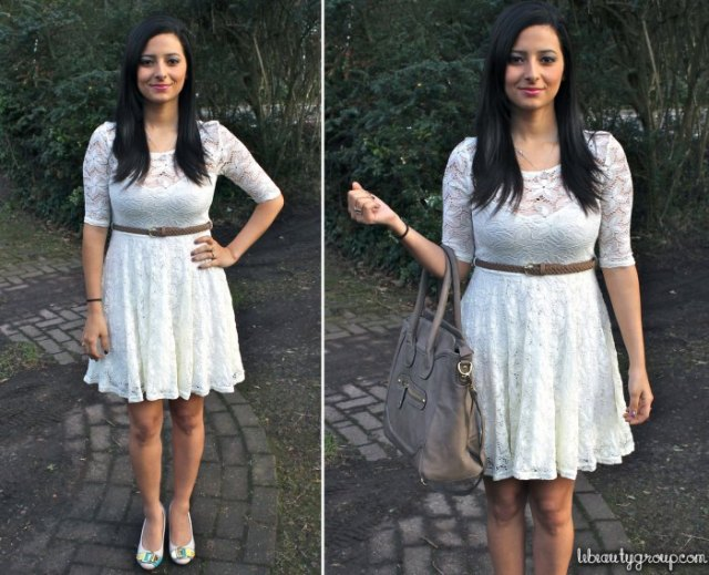 white knee-length dress with belt and half sleeves