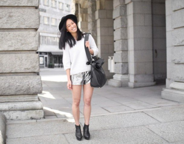 white knitted sweater with half sleeves, silver shorts and felt hat