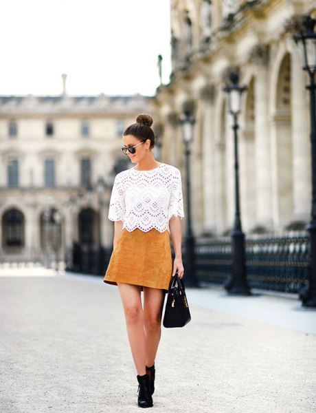 white lace top with half sleeves and tan suede mini skirt