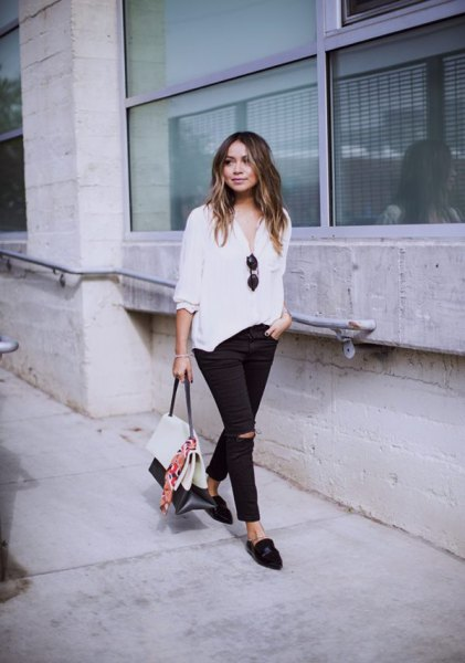 white blouse with relaxed fit and black slip fit jeans and slippers