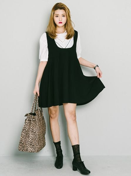 white half-sleeved sweater with black suspender mini swing dress