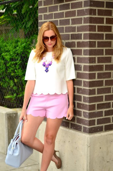 white half-sleeve T-shirt neon pink scalloped mini shorts