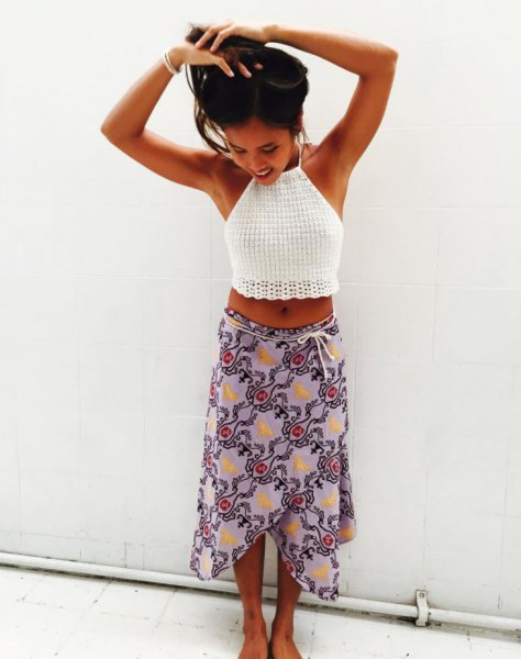 short knitted top with white halter neck and light blue printed wrap-around chiffon midi skirt