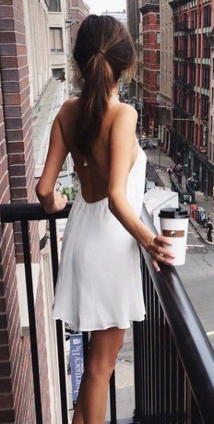 white halterneck mini dress with a low back