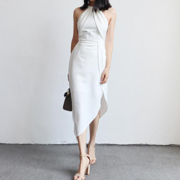white halterneck dress with a gathered waist and asymmetrical tulip dress