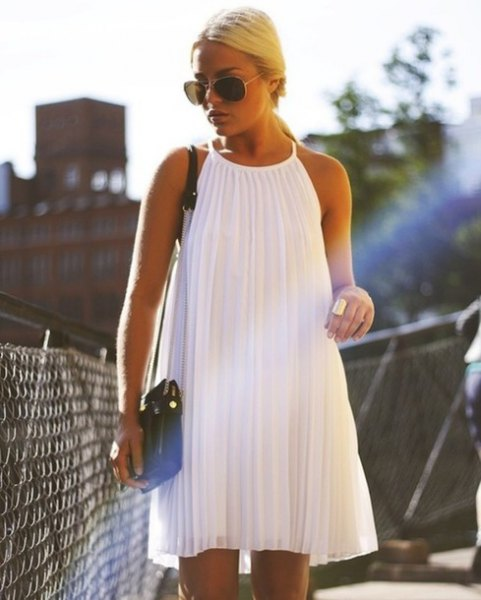 white halterneck pleated swing dress
