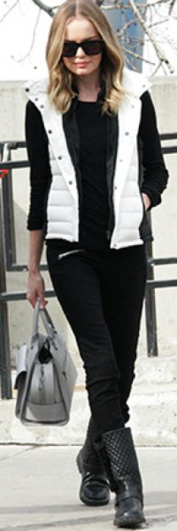 white hooded vest with black sweater and jeans