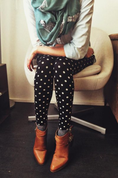 white hoodie with dotted leggings and brown leather boots