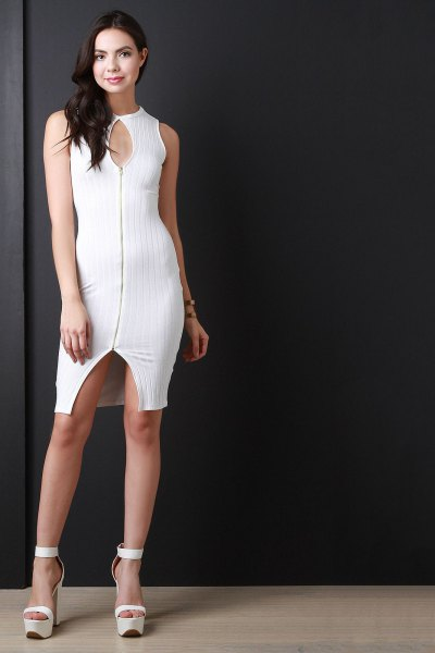 white, figure-hugging mini dress with keyhole zip at the front