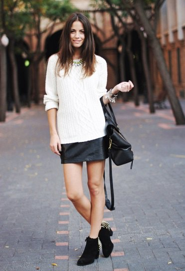 white knitted sweater black leather mini skirt in winter
