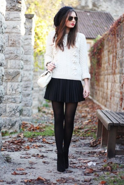 white knitted sweater black mini skirt