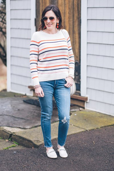 white knitted sweater with blue jeans and slippers