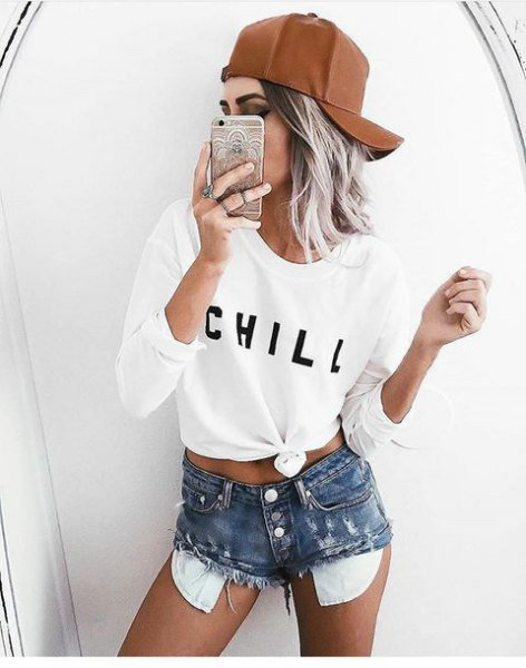 white knotted long-sleeved T-shirt with high-waisted distressed shorts