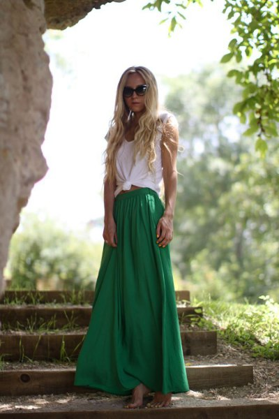 white knotted sleeveless T-shirt with green maxi skirt