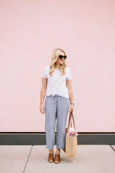 white knotted t-shirt with dark blue striped beach pants