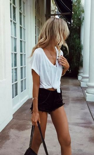 white knotted V-neck t-shirt and black high-waisted denim shorts
