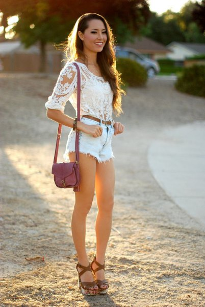 white lace blouse with light blue denim shorts and sandals