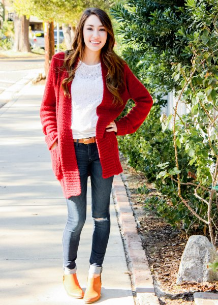 white lace blouse with a red, chunky cardigan