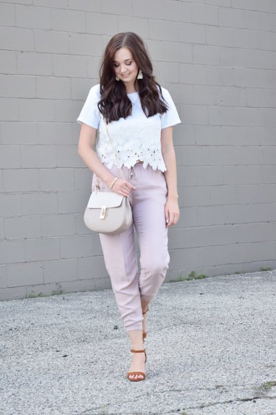 white lace top with gray high pants with straight legs