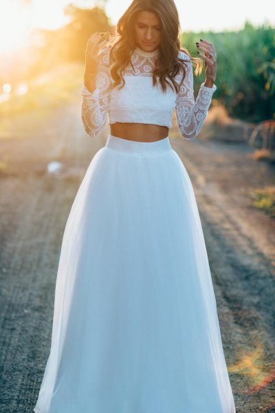 white lace cropped blouse with high waist long white tulle skirt
