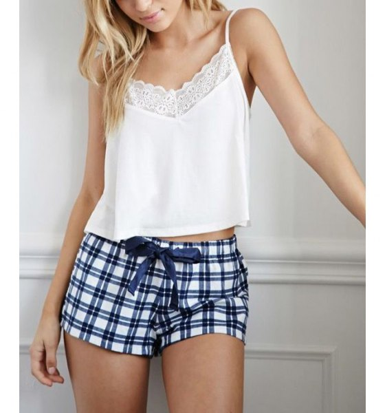 short cut camisole made of white lace with dark blue and white checked mini shorts