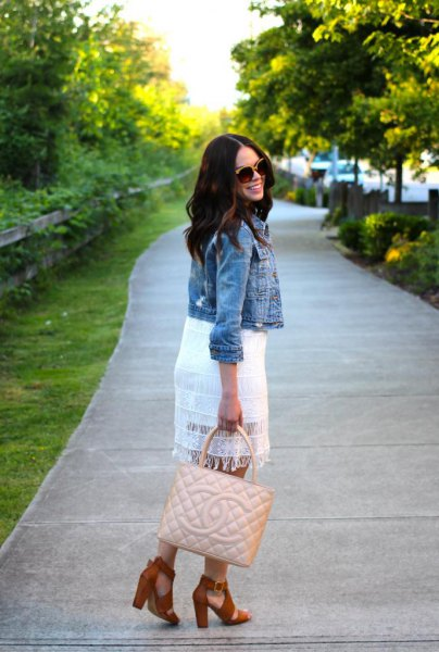 white lace dress with a short denim jacket
