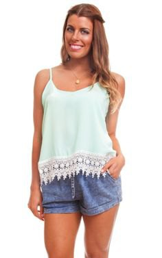 white lace top with blue mini denim shorts