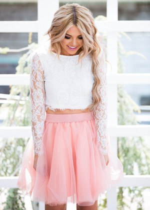 white lace long sleeved cropped blouse with blush pink tulle mini skirt