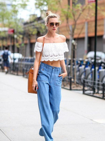 white lace off the strapless crop top with blue wide leg jeans