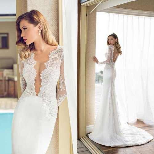 flowing wedding dress made of white lace with a deep neckline