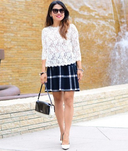white lace blouse with scalloped hem and black checked skirt