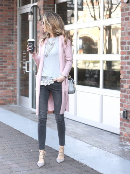 white lace blouse with scalloped hem and gray sweater