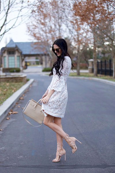 Mini swing dress with white lace and scalloped hem and pink strappy heels