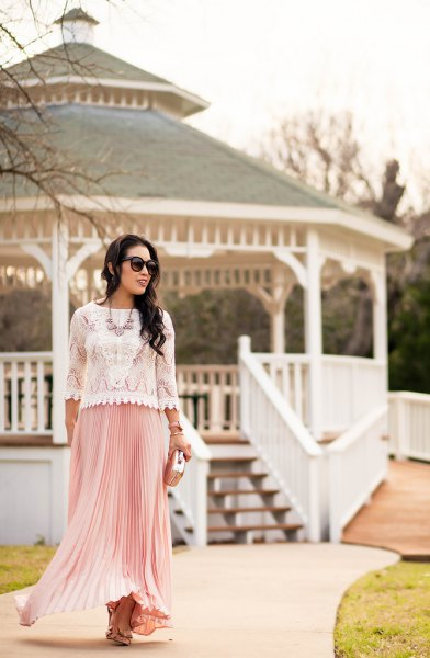 white lace sweater with scalloped hem and pink pleated maxi skirt