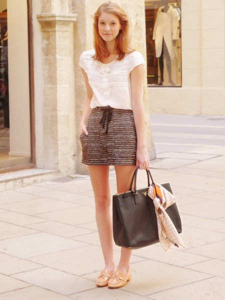 Short-sleeved white lace blouse with black and white printed mini shorts