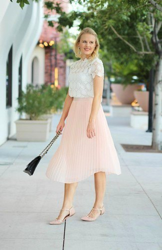 white lace short-sleeved blouse with a light yellow pleated skirt