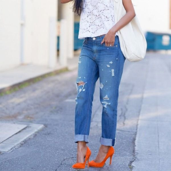 white lace short-sleeved top with blue tied boyfriend jeans