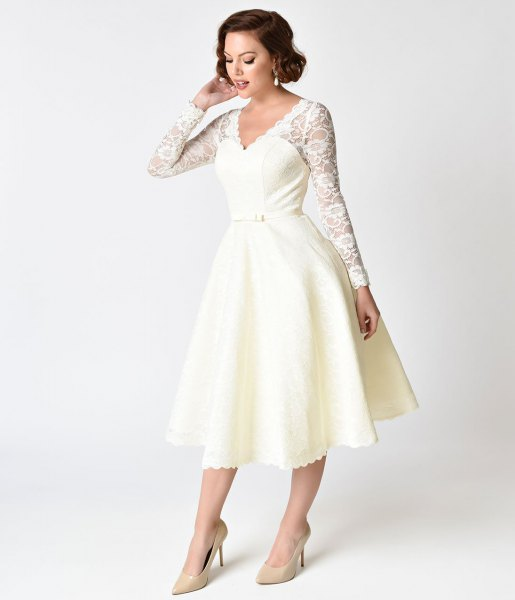 white lace dress with scalloped edge and swing dress in the style of the 1950s