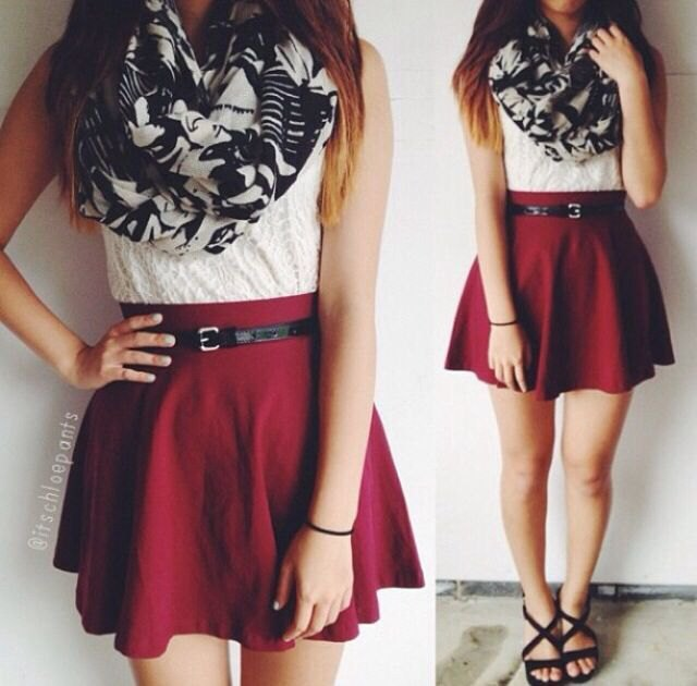 sleeveless blouse made of white lace with a burgundy skater skirt with belt