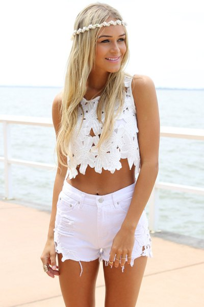 sleeveless white lace crop top with high-waisted shorts