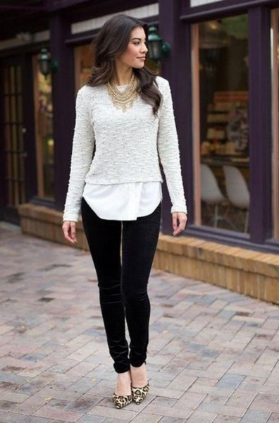 white lace sweater over tunic blouse and black velvet trousers