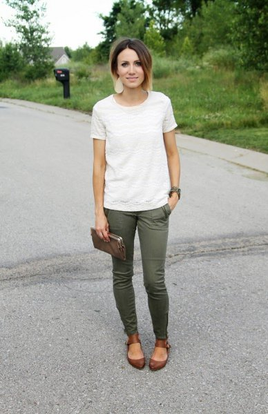white lace t-shirt with green skinny jeans