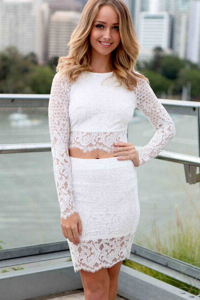 white lace top with matching figure-hugging mini skirt