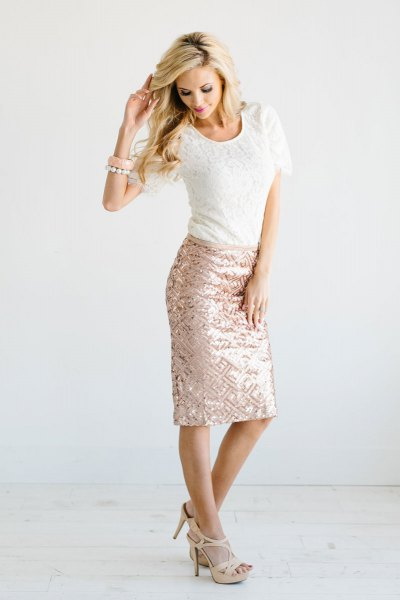 white lace top with rose gold-colored, figure-hugging midi skirt