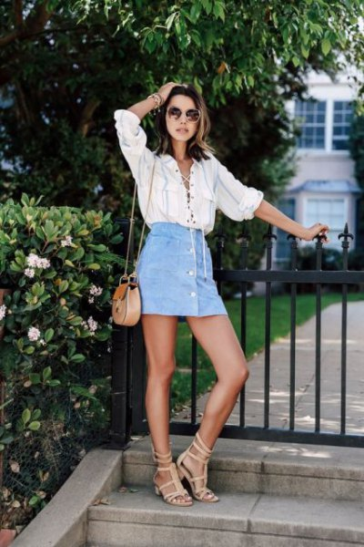white lace-up shirt with light blue mini skirt with jeans button in front